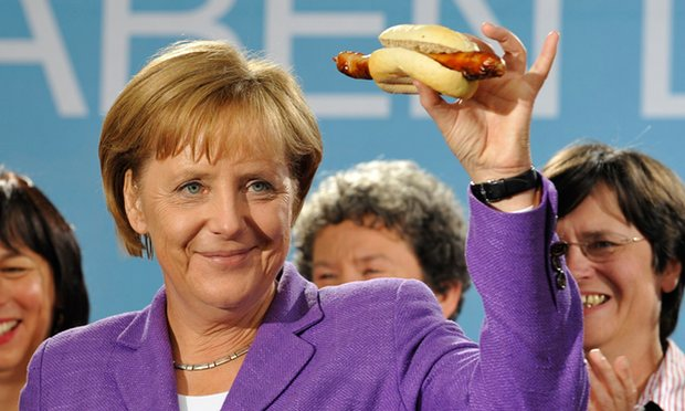merkel-w-sausage-courtesy-guardian